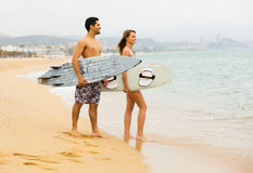 Family resting with surf boards Stock Images