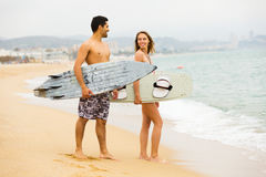 Family resting with surf boards Royalty Free Stock Image