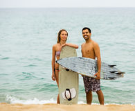 Family resting with surf boards Stock Image