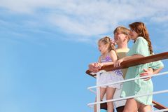 Family rests it at sea and looks far from yacht Royalty Free Stock Photos
