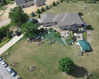 Family reunion - Aerial. Aerial of family reunion at Indiana home. Participants are playing bocce ball in the front yard stock photos
