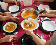 Family reunion at noon. Serving soup to lunch stock image