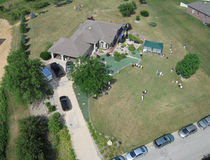 Family reunion2 - Aerial. Aerial of family reunion at Indiana home. Participants are playing bocce ball in the front yard royalty free stock image