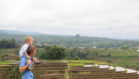 Family in rice fields of Bali Stock Photo