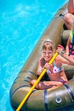 Family ride rubber boat. In water park Royalty Free Stock Photography