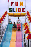 Family Rides Fun Slide At Atlanta Fair Royalty Free Stock Image