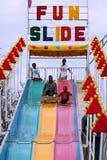 Family Rides Fun Slide At Atlanta Fair Royalty Free Stock Image