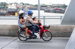 Family rides on motorbike to go home Royalty Free Stock Image