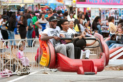 Family Rides Scrambler Carnival Ride At Atlanta Fair Stock Images
