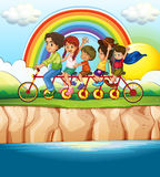Family riding bicycle along the river Royalty Free Stock Photo