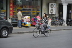 Family riding bicycle Stock Image