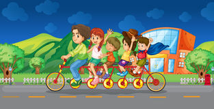 Family riding on bicycle at night Stock Photography