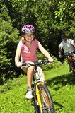 Family riding bicycles Royalty Free Stock Photography