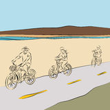 Family Riding Bicycles On The Beach Royalty Free Stock Photos