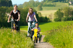 Free Family Riding Bicycles In Summer Stock Images - 17915524