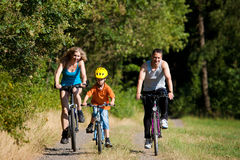 Family riding bicycles for sport Stock Photos
