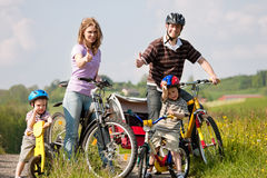 Family riding bicycles in summer Stock Image