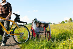 Family riding bicycles in summer Royalty Free Stock Images