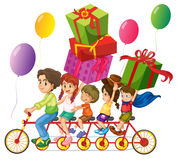Family riding on bike with present boxes Royalty Free Stock Images