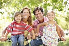 Family riding bikes Royalty Free Stock Photography