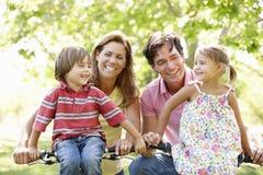 Family riding bikes Stock Photo