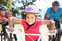 Family riding bikes having fun royalty free stock photo