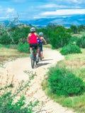 Family riding bikes on the mountian trail. royalty free stock photos