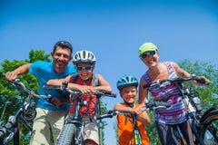 Family riding bikes Royalty Free Stock Photo