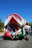 Family riding in a caravan, Marbella. Royalty Free Stock Photo