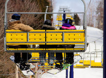 Family Riding on Chairlift Royalty Free Stock Photo
