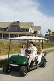 Family riding in golf cart. Royalty Free Stock Photos