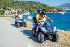 Free Family Riding Quad Bike. Cute Boy And His Father On Quadricycle. Motor Cross Sports On Greece Island. Family Summer Royalty Free Stock Images - 143951719