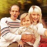 Family on spinning roundabout Royalty Free Stock Image