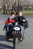 Family riding a three wheeled bicycle Stock Photography