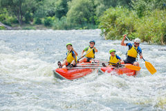 Family River Rafting Stock Image