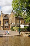 Family at riverside, Bourton on the Water. Royalty Free Stock Images