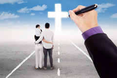 Family on the road with crucifix Stock Image