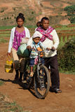 Family on the road through the fields Royalty Free Stock Photography