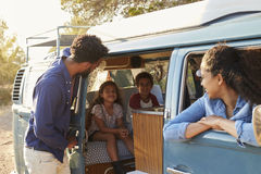 Family on a road trip making a stop in their camper van Royalty Free Stock Photo