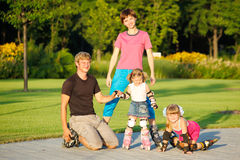 Family in roller skates Royalty Free Stock Image