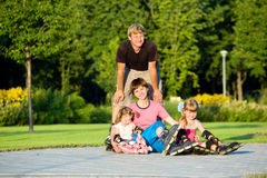 Family in roller skates Stock Images