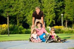 Family in roller skates Stock Images