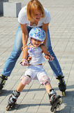 Family rollerblading Royalty Free Stock Image