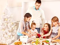 Family  rolling dough in Xmas kitchen. Stock Photography