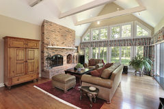 Family room with brick fireplace Stock Image