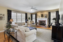 Family room with brick fireplace Stock Photo