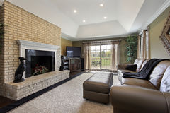 Family room with brick fireplace Stock Photography