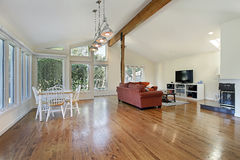 Family room with ceiling wood beam Stock Photos