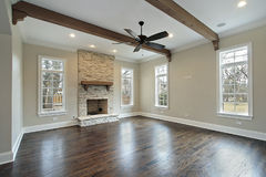 Family room with ceiling wood beams royalty free stock photography