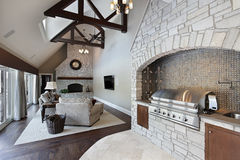 Family room with ceilling wood beams. Family room with ceiling wood beams and grill stock photos